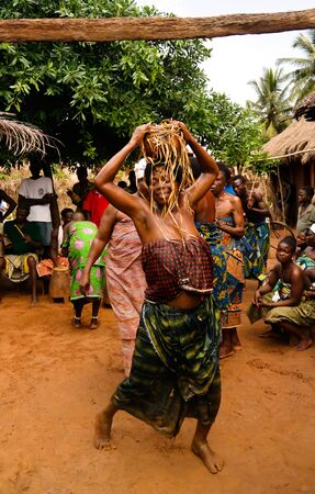 Portrait of woman dancing woodoo dance. 01 November 2015 Anfoin, Togo