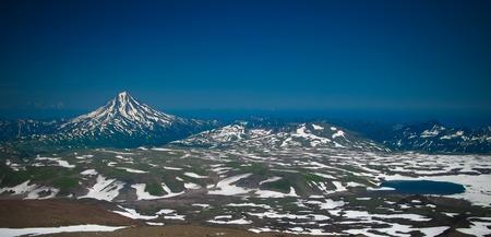 View to Viluchinsky volcano from the caldera of Mutnovsky at Kamchatka peninsula, Russia Фото со стока - 100626848