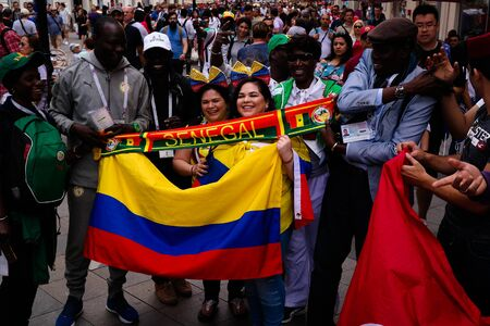 Senegalese and Colombian Football fans at Nikolskaya Street in Moscow at FIFA football world cup - 21 June 2018, Moscow, Russia