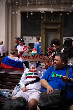 Mexican Football fans at Nikolskaya Street in Moscow at FIFA football world cup - 21 June 2018, Moscow, Russia 에디토리얼