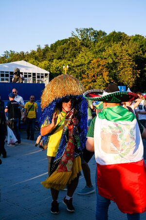 Mexican and Brazilian Football fans in the FIFA fan fest at Sparrow Hills aka Vorobyovy Gory in Moscow at FIFA football world cup - 27 June 2018, Moscow, Russia