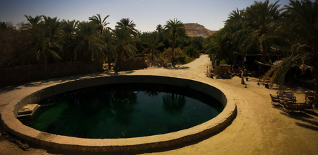Landscape with Cleopatra bath in Siwa oasis at Egypt