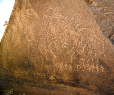 elephant and men- Cave paintings and petroglyphs at Boumediene in Tassili nAjjer national park, Algeria Stock fotó
