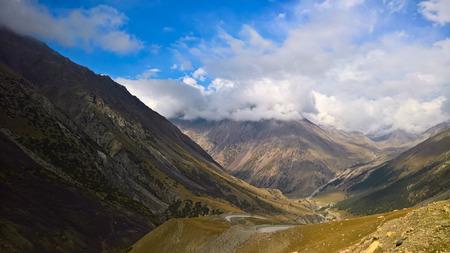 serpentine road to Barskoon pass, river and gorge and Sarymoynak pass at Jeti-Oguz, Kyrgyzstan Zdjęcie Seryjne