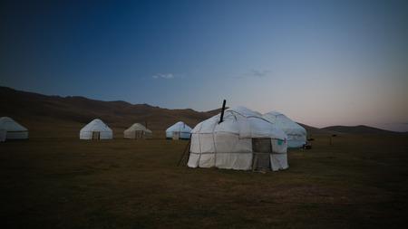 yurts at the shore of Song Kol Lake at the dawn at Kyrgyzstan