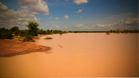 Panoramic landscape view to sahel and oasis Dogon Tabki with flooded river at Dogondoutchi, Niger Stock Photo
