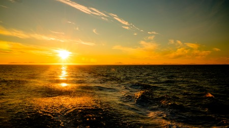 Sunset and sunrise over the sea and Lofoten archipelago from the Moskenes - Bodo ferry in Norway Stock fotó