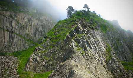 Column basalts formation of Stolbchaty cape at Kunashir at kuril islands, Russia