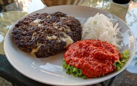 Traditional serbian and balkan dish Pljeskavica with sauce in Maribor,Slovenia 写真素材