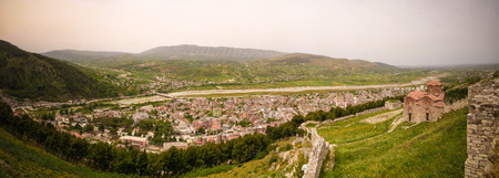 Panoramic aerial view to Berat old town and Osum river Holy Trinity Church from Berat Castle in Albania