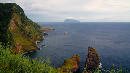 View to coastline of Flores island and Corvo island from Miradouro dos Caimbros at Azores, Portugal