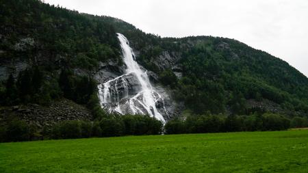Panoramic view to Vidfossen waterfall at Gronsdalslona river in Odda , Norway