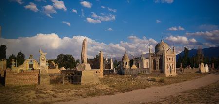 Panorama view to muslim cemetery Semiz Bel at sunset at Kochkor in Naryn region , Kyrgyzstan 写真素材
