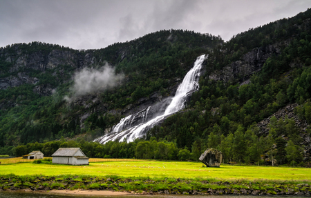 Panoramic view to Vidfossen waterfall at Gronsdalslona river in Odda , Norway