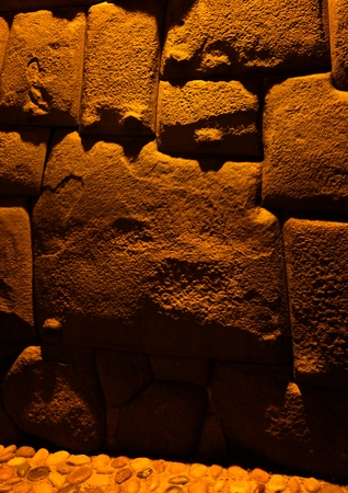 View to Twelve-angled stone aka Hatun Rumiyoc as a part of a wall of the palace of the Archbishop of Cuzco in Peru