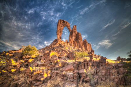 Abstract Rock formation at plateau Ennedi aka window arch at sunrise, in Chad
