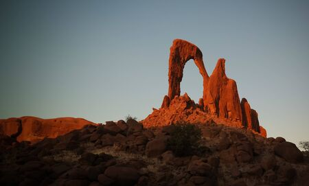 Abstract Rock formation at plateau Ennedi aka window arch at sunset, in Chad