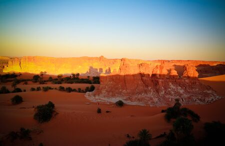 Sunrise at sandstone formation in the Sahara desert near Yoa Lake group of Ounianga Kebir in Ennedi, Chad
