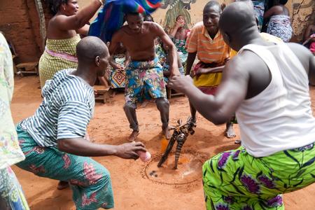 Portrait of Ewe and Gen man dancing woodoo dance. 01 November 2015 Anfoin, Togo