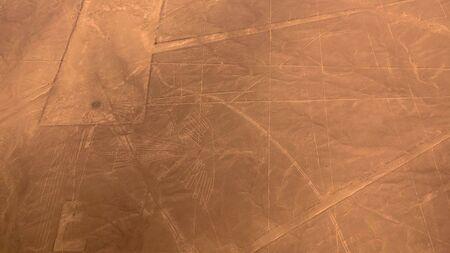 Aerial airplane panoramic view to Nazca geoglyph lines aka Condor, Ica region, Peru