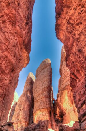Bottom-up view to Abstract Rock formation at plateau Ennedi aka stone forest , Chad
