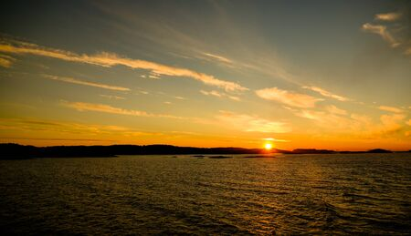 Sunset and sunrise over the sea and Lofoten archipelfgo from the Moskenes - Bodo ferry in Norway