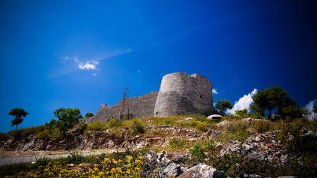 Landscape with the Lekuresi Castle and military bunkers near Saranda, Albania