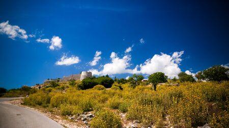 Landscape with the Lekuresi Castle and military bunkers near Saranda, Albania 스톡 콘텐츠 - 133301127