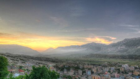 Aerial evening panoramic view to Gjirokaster city in Albania 스톡 콘텐츠