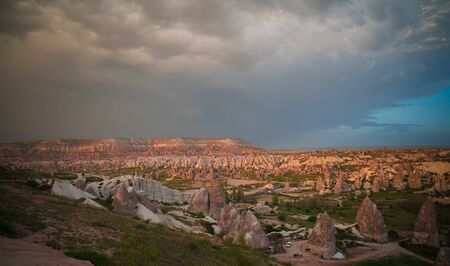 Sunset panoramic view to Goreme city and Red, Rose and meskendir valleys Cappadocia, Turkey