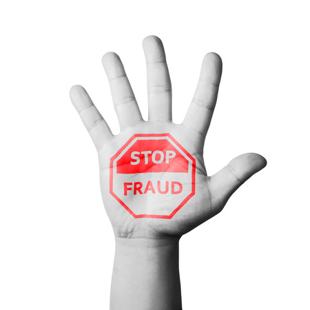 Open hand raised, Stop Fraud sign painted photo