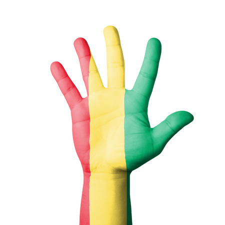 Open hand raised, Guinea flag painted photo