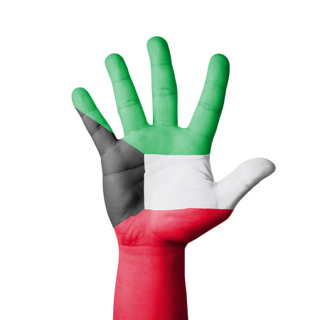 Open hand raised, Kuwait flag painted photo