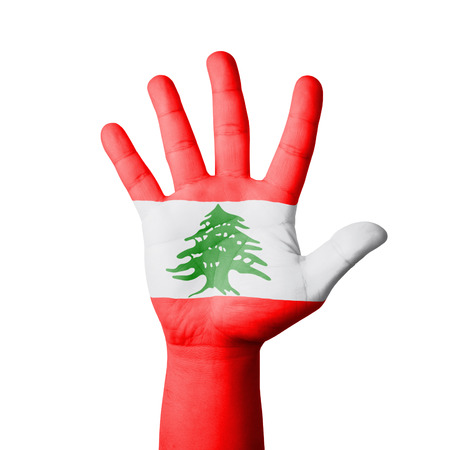 Open hand raised, Lebanon flag painted photo