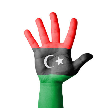 Open hand raised, Libya flag painted photo