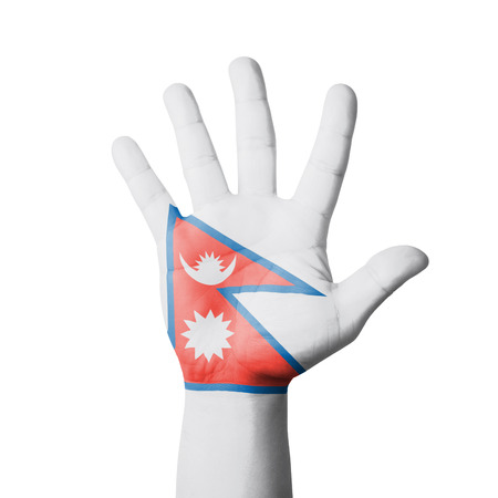Open hand raised, Nepal flag painted photo
