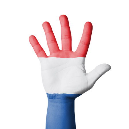 Open hand raised, Netherland flag painted photo