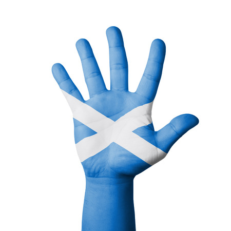 Open hand raised, Scotland flag painted photo