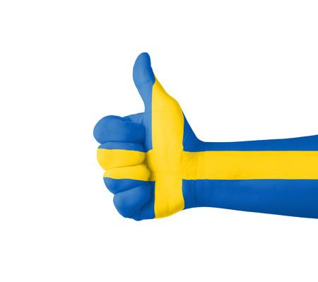 bandera de suecia: Mano con el pulgar arriba, Suecia bandera pintada Foto de archivo
