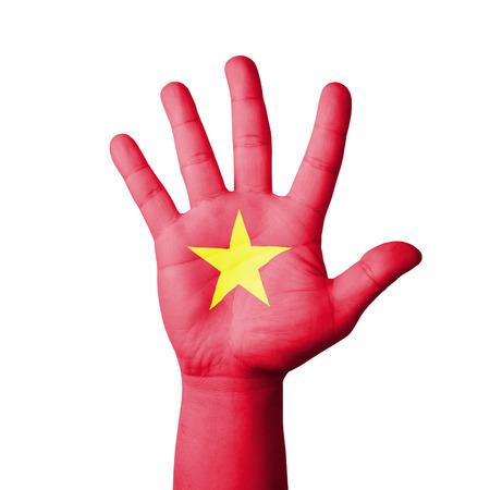 Open hand raised, Vietnam flag painted photo