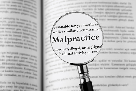 malpractice: Malpractice, holding Magnifying Glass . Studio Shot.