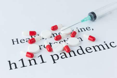 h1n1: Syringe and Pills on h1n1