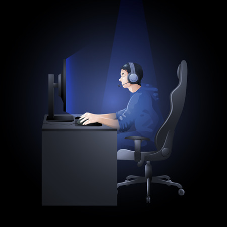 major battle: Young man sitting at the table and playing computer. Side view. Cyber sport concept.