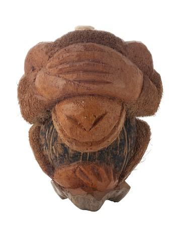 ashamed: Botella tallada en un coco en la forma de un mono verg�enza aislado en el fondo blanco.  Foto de archivo