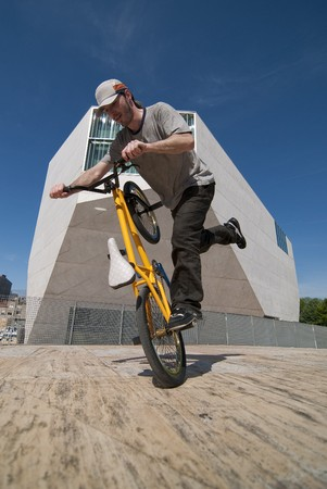 flatland: Bmx flatland training on a sunny day in a  city. Stock Photo