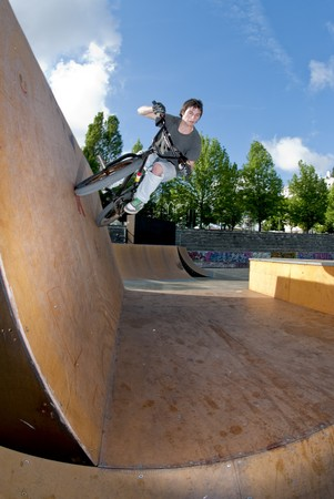 Bmx Bike Stunt Wall Ride on a skatepark. photo