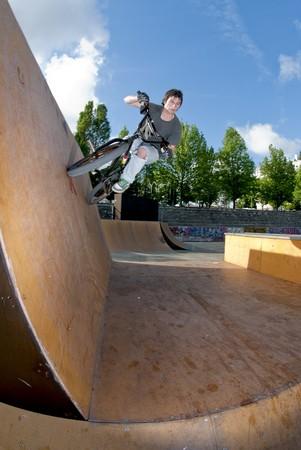 Bmx Bike Stunt Wall Ride on a skatepark. photo
