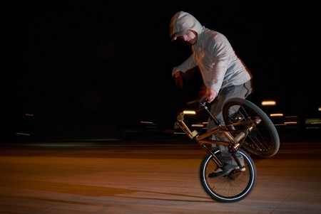 Bmx flatland training at night in a  city. photo