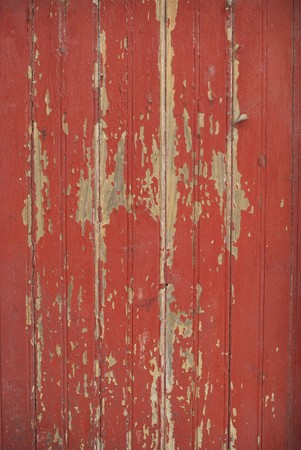 weathered: Part of a old woodboard texture painted on red.