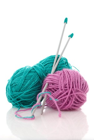Balls of green and pink  knitting wool or yarn, with silver knitting needles. Stock Photo - 7458587